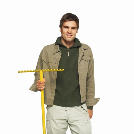 portrait of a man holding a rake : Stock Photo