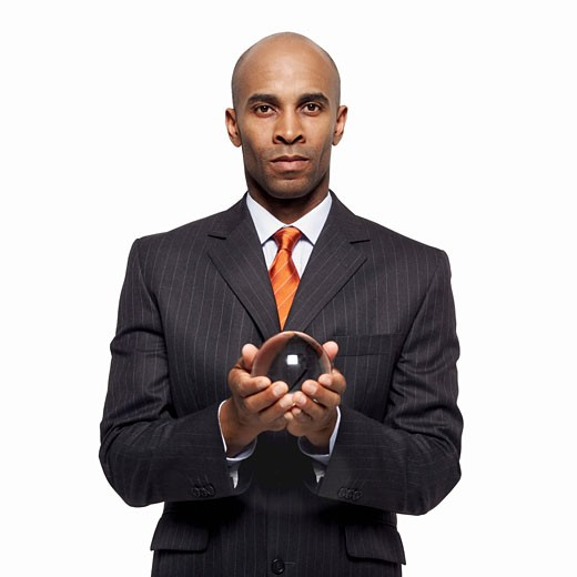 close up of a businessman holding a crystal ball : Stock Photo