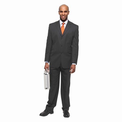 Stock Photo: 1491R-1064035 portrait of a smiling businessman carrying a briefcase
