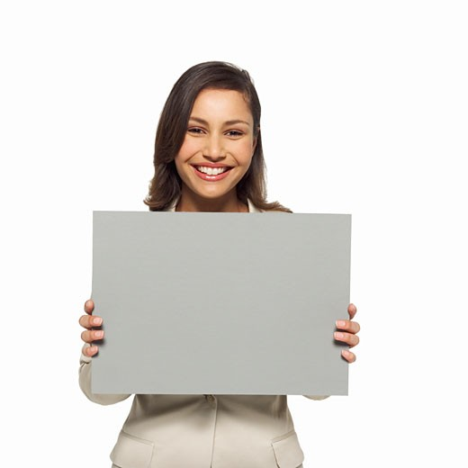 Portrait of businesswoman holding blank card : Stock Photo