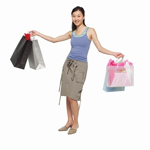 Stock Photo: 1491R-1064146 front view portrait of a woman holding shopping bags