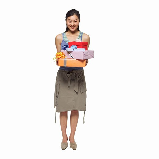 portrait of a woman holding gifts : Stock Photo
