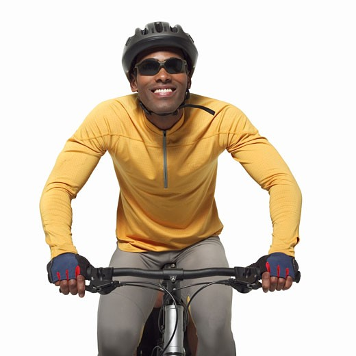Stock Photo: 1491R-1064187 portrait of a man wearing cycling gear on a bicycle