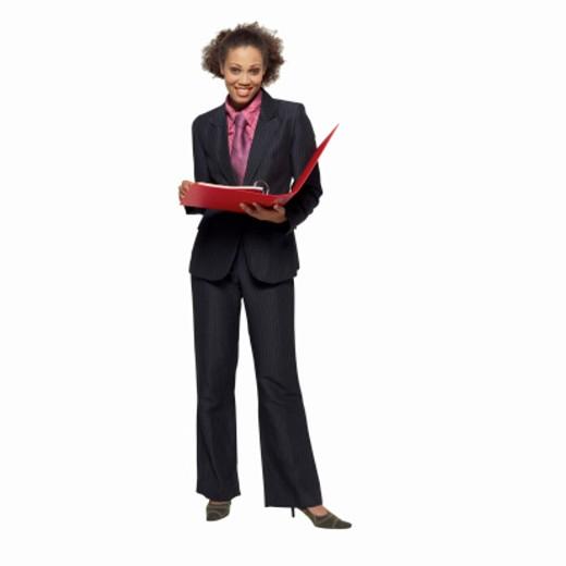 Stock Photo: 1491R-1064207 Portrait of businesswoman holding folder