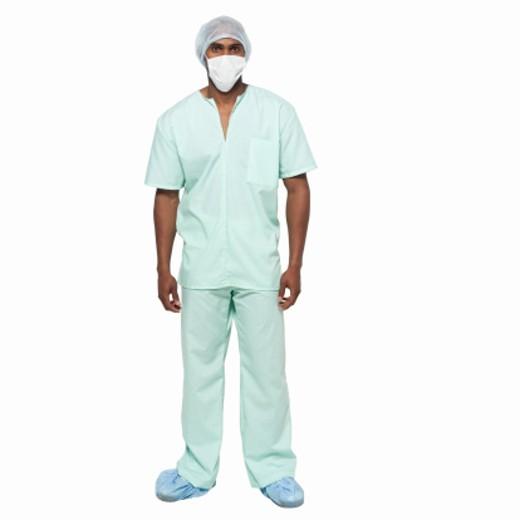 Portrait of male surgeon standing : Stock Photo