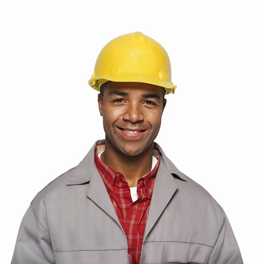 close up portrait of a man wearing a hard hat : Stock Photo