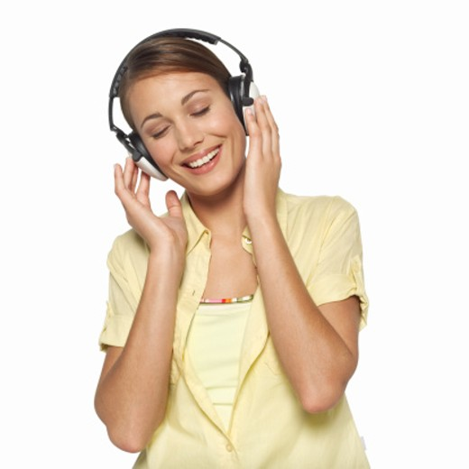 Portrait of young woman wearing headphones : Stock Photo