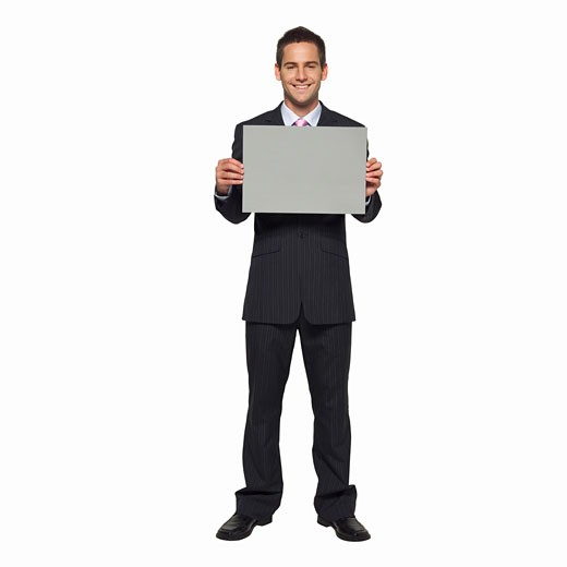 Portrait of businessman holding blank card : Stock Photo
