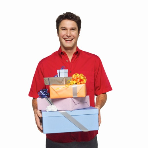 portrait of a man carrying gifts : Stock Photo