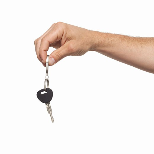 Close-up of man's hand holding key : Stock Photo