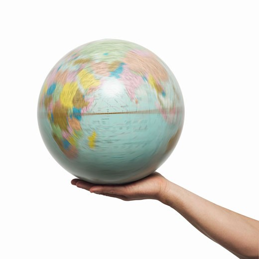 Close-up of man's hand holding globe : Stock Photo