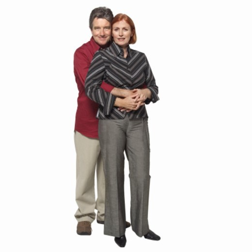 Front view portrait of senior couple holding each other : Stock Photo