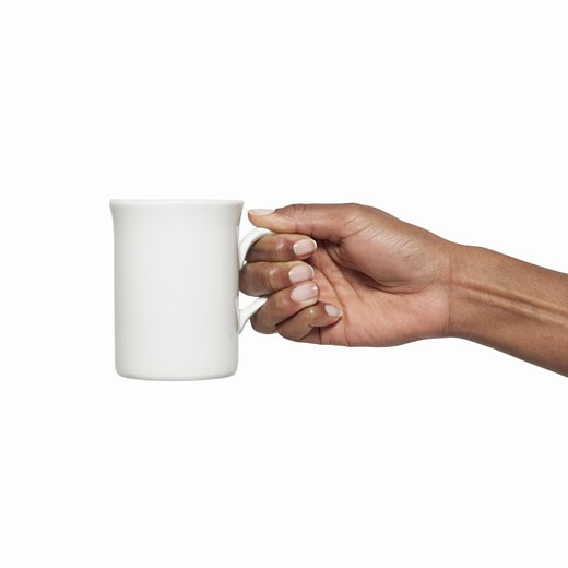 Close-up of female hand holding mug : Stock Photo