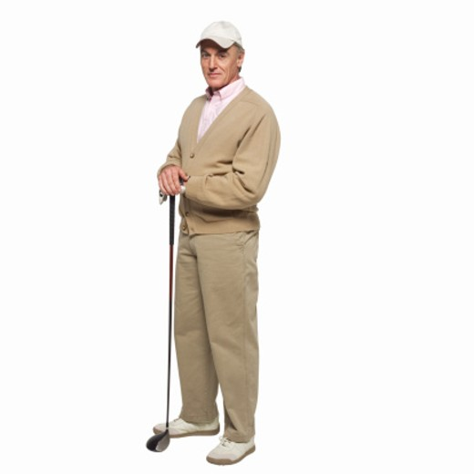 Stock Photo: 1491R-1064668 Mature golfer holding golf club