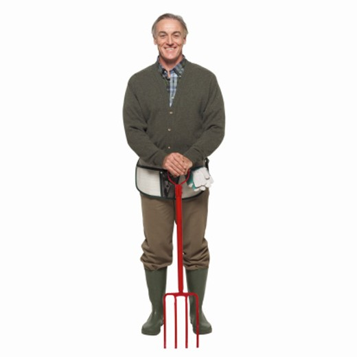 Front view portrait of mature man wearing Wellingtons and holding pike : Stock Photo
