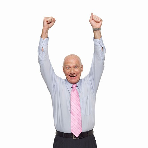 Front view portrait of mature businessman with arms raised : Stock Photo