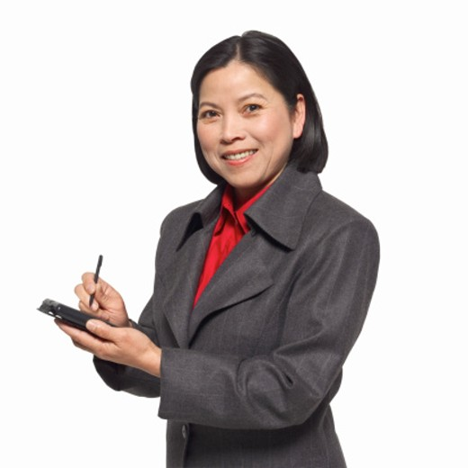 Close-up of mature woman holding pda : Stock Photo