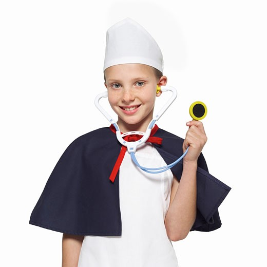 front view portrait of a girl (11-12) wearing nurse's uniform and holding stethoscope : Stock Photo