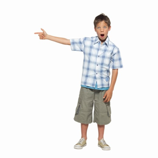 front view portrait of a shocked boy (11-12) pointing his finger : Stock Photo