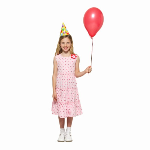 Stock Photo: 1491R-1064766 front view portrait of a girl (11-12) holding balloon