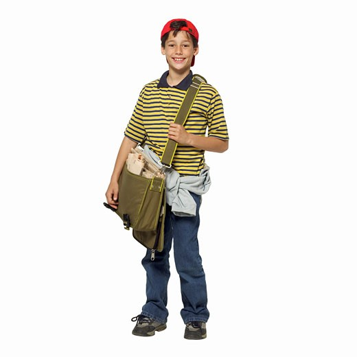 Stock Photo: 1491R-1064816 Front view portrait of a boy (11-12) holding paper bag