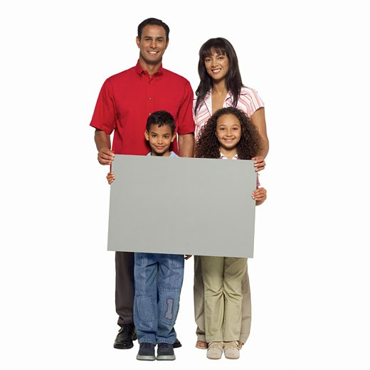 Stock Photo: 1491R-1064868 Portrait of parents with their daughter (11-12) and son (10-11) holding blank placards