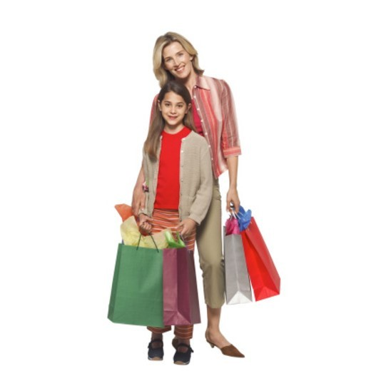 Stock Photo: 1491R-1064901 Portrait of a mother and daughter (12-13) holding shopping bags