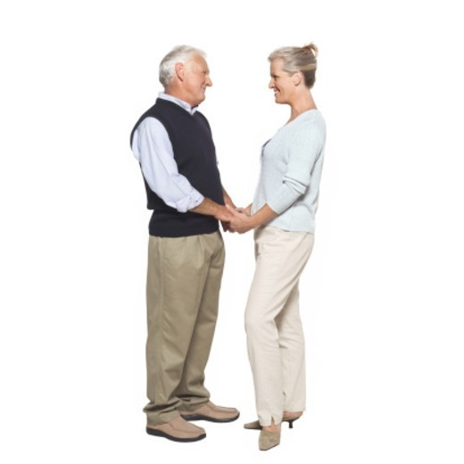 Stock Photo: 1491R-1064949 Side view of a husband and wife holding hands
