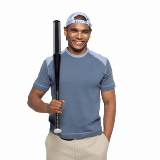 Stock Photo: 1491R-1065011 Portrait of a man holding a baseball bat