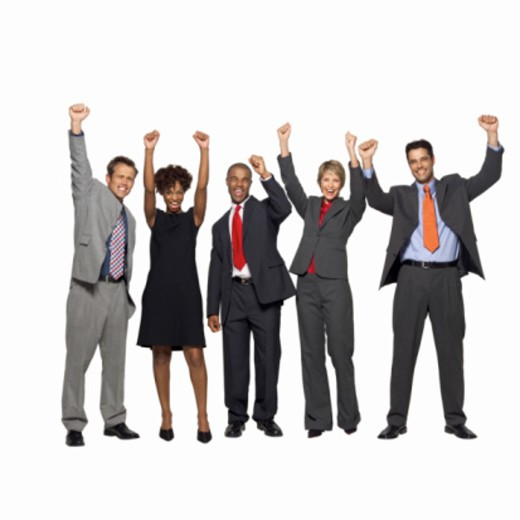 Portrait of five business executives raising their arms in the air : Stock Photo
