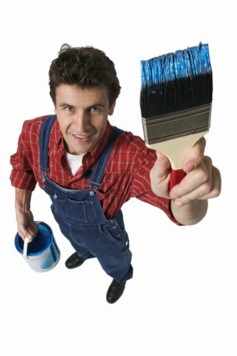 elevated portrait of a man holding a paintbrush : Stock Photo