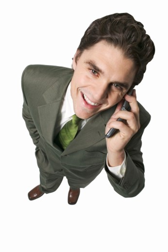 Elevated view of young businessman talking on mobile phone : Stock Photo