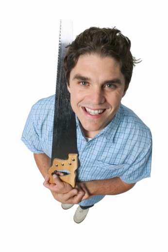 elevated portrait of a man holding a saw : Stock Photo