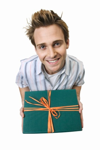 Stock Photo: 1491R-1065342 elevated view of a man holding a gift