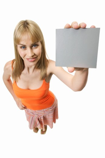 Elevated view of young woman holding placard : Stock Photo