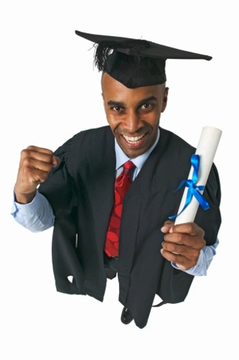 elevated view of a man wearing cap and gown and holding a certificate : Stock Photo