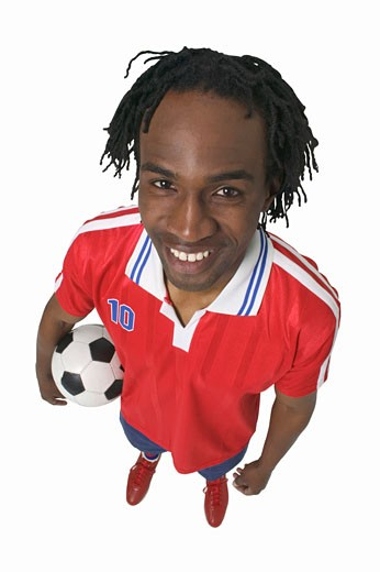 elevated view of a man holding soccer ball : Stock Photo