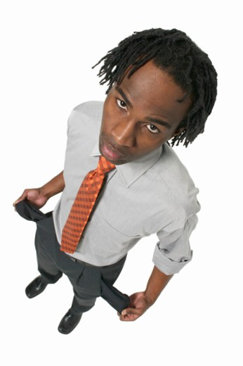Stock Photo: 1491R-1065554 elevated view of a businessman pulling out trouser pocket lining
