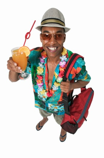 Portrait of man holding cocktail and bag : Stock Photo