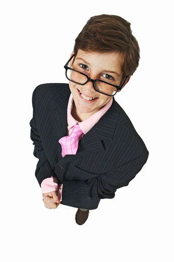 Elevated view of a boy (11-12) dressed up as a businessman : Stock Photo