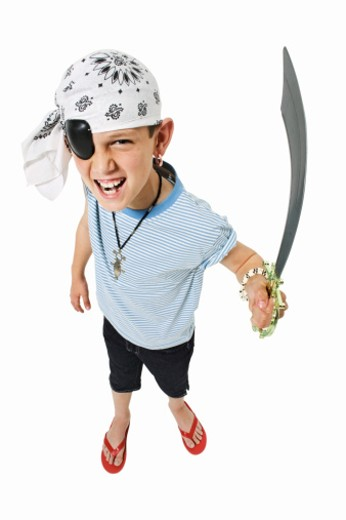 Stock Photo: 1491R-1065942 Elevated view of a boy (11-12) dressed up as a pirate