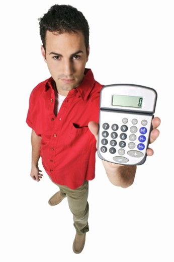 elevated view of a man holding a calculator : Stock Photo