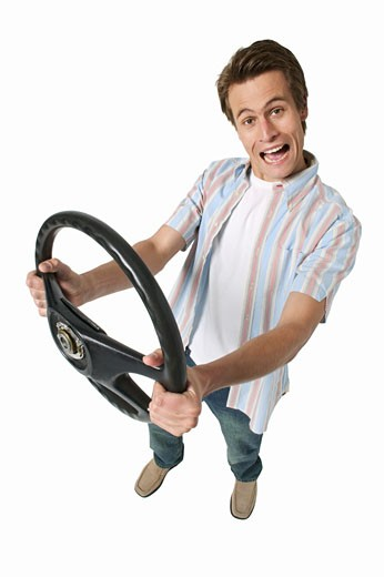 Stock Photo: 1491R-1066076 elevated view of a man holding a steering wheel