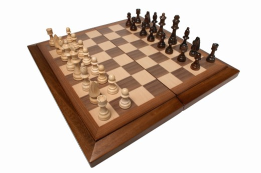 Stock Photo: 1491R-1066131 Close up of a chess board and chess pieces