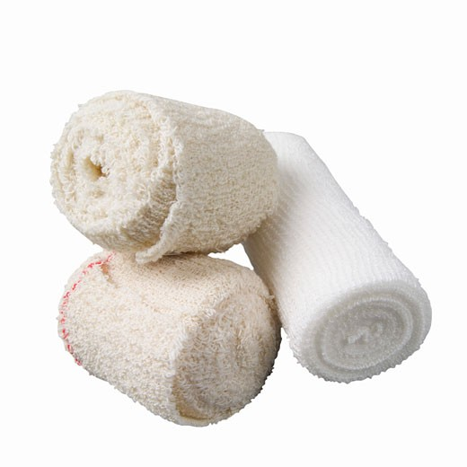 Stock Photo: 1491R-1066475 Close up of three rolls of bandages