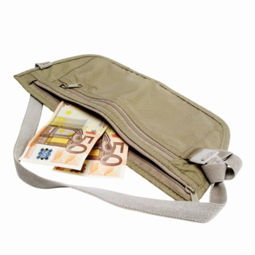 Close up of 50 euro notes sticking out of handbag : Stock Photo