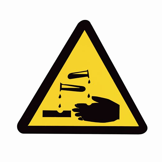 Close up of a chemical danger sign : Stock Photo
