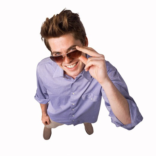 Stock Photo: 1491R-1068786 Elevated view of a man touching his sunglasses