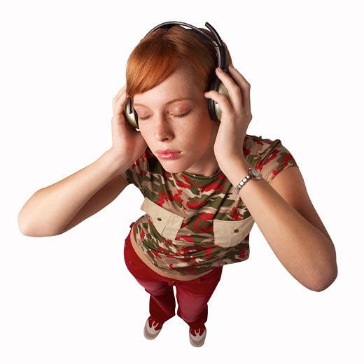 Elevated view of a woman wearing headphones : Stock Photo