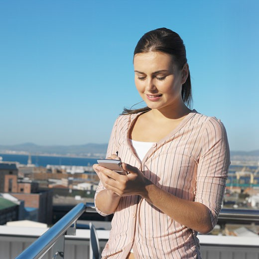 Stock Photo: 1491R-1068984 Close-up of young woman holding pda